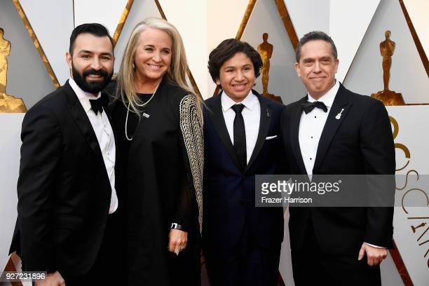 Adrian Molina Darla K Anderson and Lee Unkrich attend the 90th Annual Academy Awards at Hollywood Highland Center on March 4 2018 in Hollywood...