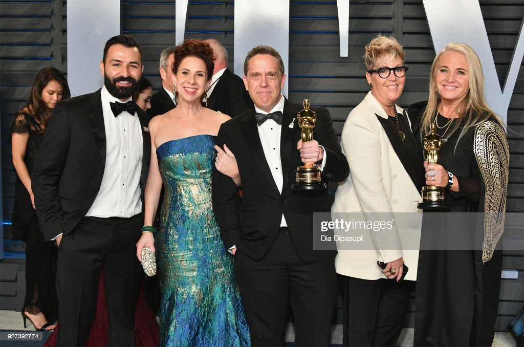 Adrian Molina, Laura Century, Lee Unkrich, Kori Rae and Darla K. Anderson attend the 2018 Vanity Fair Oscar Party hosted by Radhika Jones at Wallis Annenberg Center for the Performing Arts on March 4, 2018 in Beverly Hills, California.