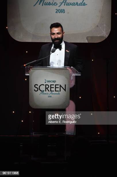 Adrian Molina speaks onstage at the 33rd Annual ASCAP Screen Music Awards at The Beverly Hilton Hotel on May 23 2018 in Beverly Hills California