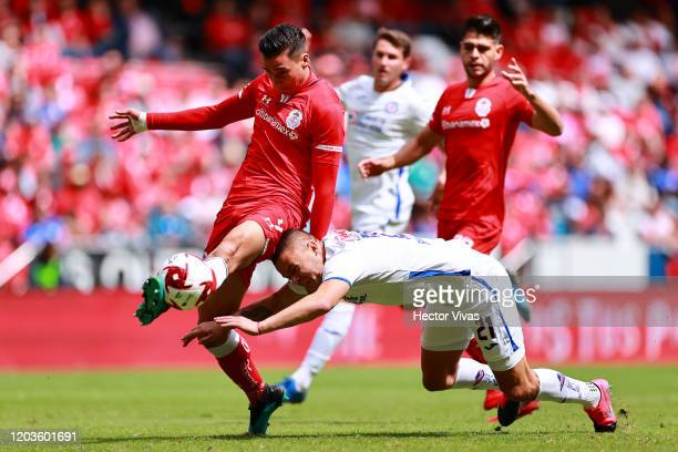 Adrian Mora of Toluca struggles for the ball against Jonathan Rodriguez of Cruz Azul during the 4th round match between Toluca and Cruz Azul as part...