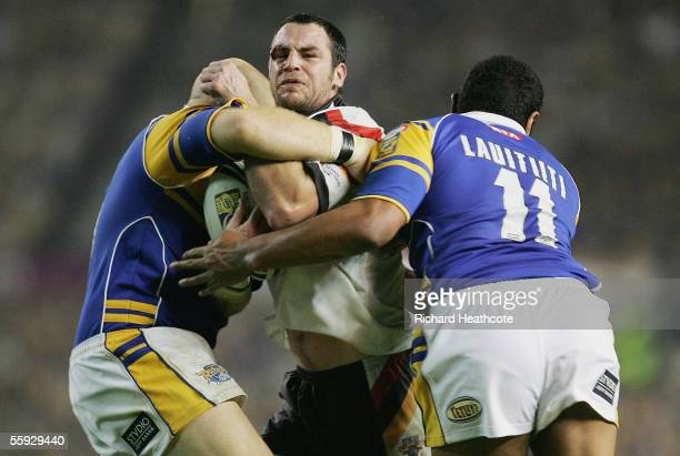 Adrian Morley of Bradford is halted by the Leeds defence during the Engage Super league Grand Final between Leeds Rhinos and Bradford Bulls at Old...