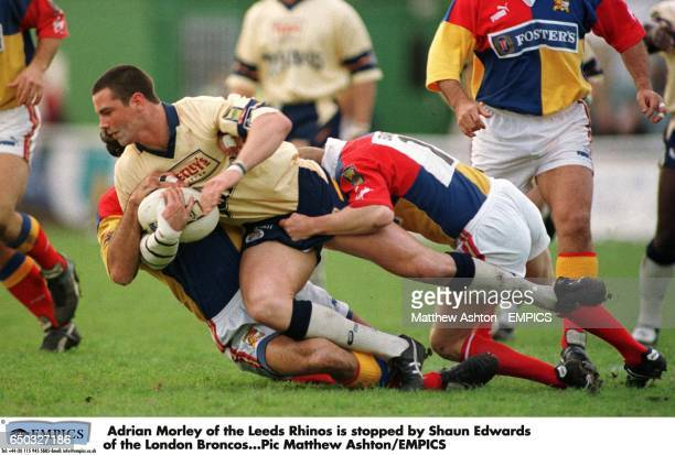 Adrian Morley of the Leeds Rhinos is stopped by Shaun Edwards of the London Broncos