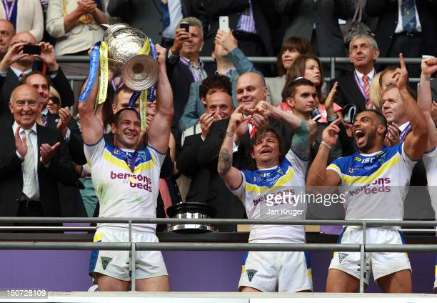 Adrian Morley of Warrington Wolves lifts the trophy during the Carnegie Challenge Cup Final between Leeds Rhinos and Warrington Wolves at Wembley...