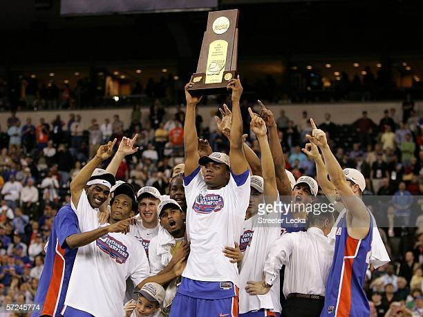 Adrian Moss and the Florida Gators celebrate with the trophy after defeating the UCLA Bruins 7357 during the National Championship game of the NCAA...
