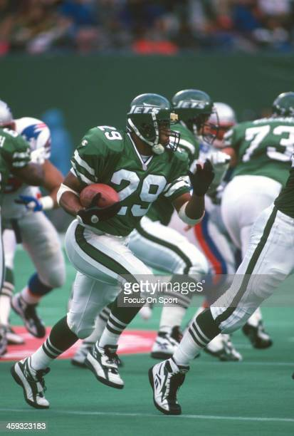 Adrian Murrell of the New York Jets carries the ball against the New England Patriots during an NFL football game on November 10 1996 at The...