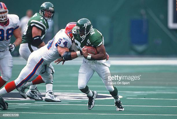 Adrian Murrell of the New York Jets gets hit by Chris Spielman of the Buffalo Bills during an NFL football game on September 7 1997 at The...