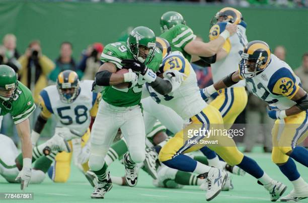 Adrian Murrell Running Back for the New York Jets tries to run the ball as Linebacker Carlos Jenkins of the StLouis Rams makes a block during the...