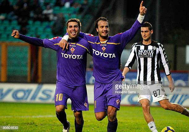 Adrian Mutu and Alberto Gilardino of ACF Fiorentina celebrate the goals scored during the Serie A match between Siena and Fiorentina at Artemio...