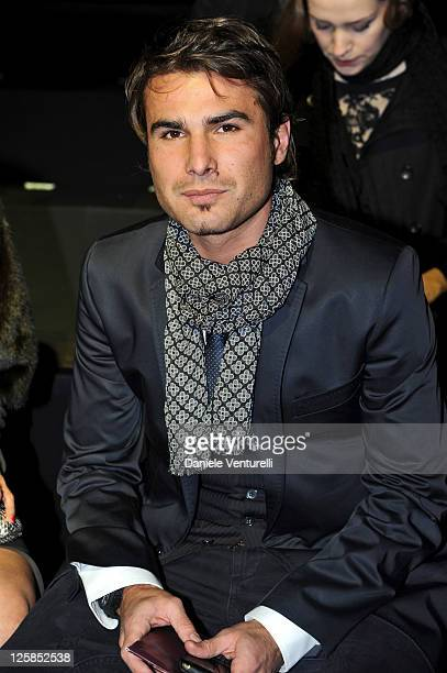 Adrian Mutu attends the Roberto Cavalli Fashion Show as part of Milan Fashion Week Menswear A/W 2011 on January 15 2011 in Milan Italy