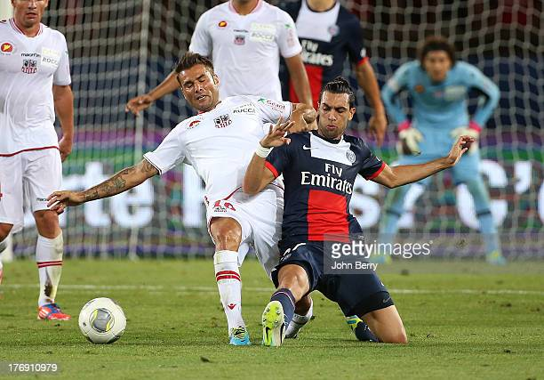 Adrian Mutu of AC Ajaccio and Javier Pastore of PSG in action during the Ligue 1 match between Paris Saint Germain FC and AC Ajaccio at the Parc des...