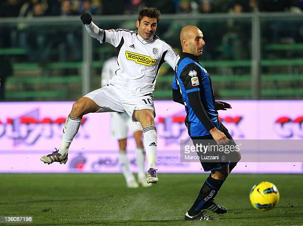 Adrian Mutu of AC Cesena is challenged by Michele Ferri of Atalanta BC during the Serie A match between Atalanta BC and AC Cesena at Stadio Atleti...