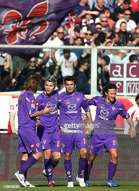 Adrian Mutu of ACF Fiorentina celebrates with team mates after scoring the opening goal during the Serie A match between ACF Fiorentina and Catania...