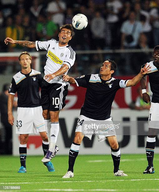 Adrian Mutu of Cesena competes for the ball with Cristian Ledesma of Lazio during the Serie A match between AC Cesena and SS Lazio at Dino Manuzzi...