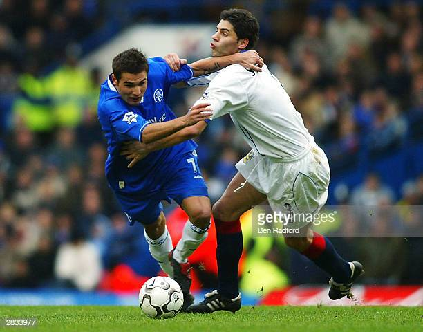 Adrian Mutu of Chelsea battles with Dejan Stefanovic of Portsmouth during the FA Barclaycard Premiership match between Chelsea and Portsmouth at...