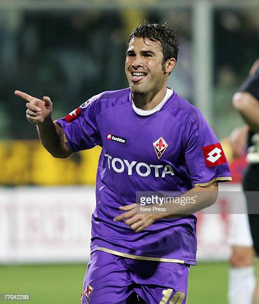 Adrian Mutu of Fiorentina celebrates his goal with team mates during the Italian serie A football match between Fiorentina and Roma at Artemio...