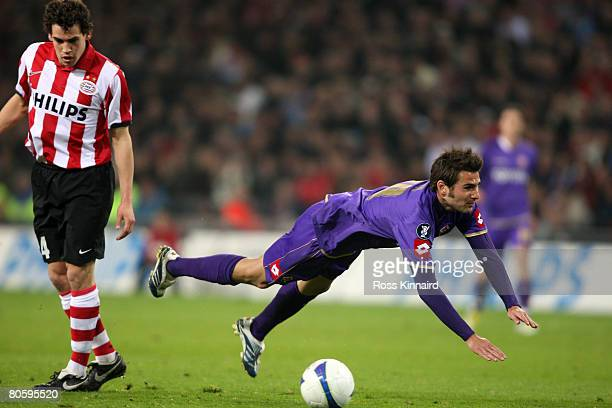 Adrian Mutu of Fiorentina is challenged by Dirk Marcellis of PSV Eindhoven during the UEFA Cup Quarter Final between PSV Eindhoven and Fiorentina at...