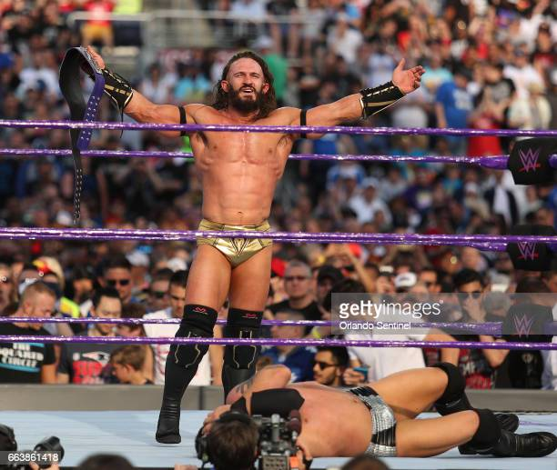 Adrian Neville celebrates his victory during WrestleMania 33 on Sunday April 2 2017 at Camping World Stadium in Orlando Fla