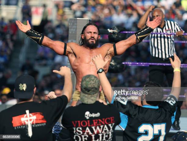 Adrian Neville celebrates with fans during WrestleMania 33 on Sunday April 2 2017 at Camping World Stadium in Orlando Fla