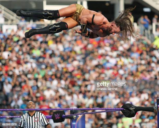 Adrian Neville leaps over the ring during WrestleMania 33 on Sunday April 2 2017 at Camping World Stadium in Orlando Fla