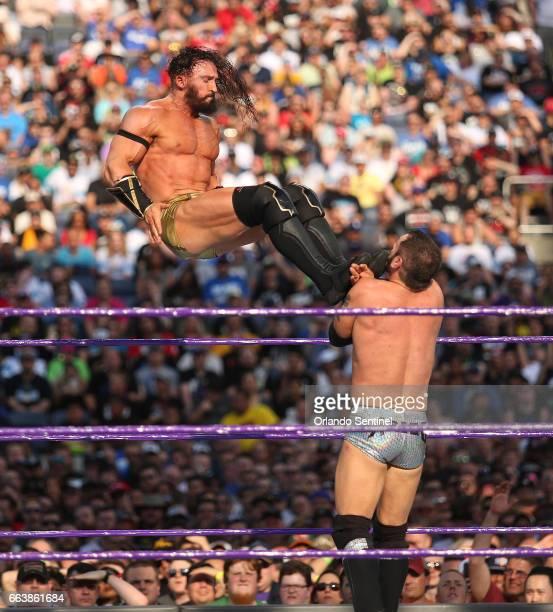 Adrian Neville top kicks Austin Aries during WrestleMania 33 on Sunday April 2 2017 at Camping World Stadium in Orlando Fla