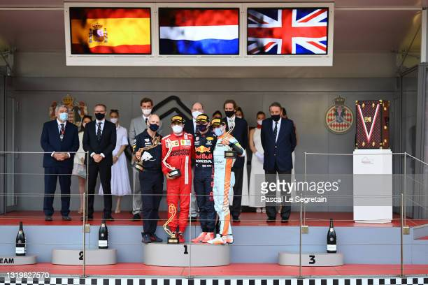Adrian Newey, Carlos Sainz Jr., Max Verstappen and Lando Norris pose with their prize on the podium during F1 Grand Prix of Monaco at Circuit de...