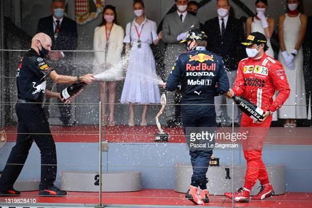Adrian Newey, Max Verstappen and Carlos Sainz Jr. Celebrate on the podium during F1 Grand Prix of Monaco at Circuit de Monaco on May 23, 2021 in...