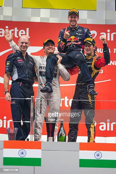 Adrian Newey of Red Bull and Great Britain Nico Rosberg of Germany and Mercedes race winner and 2013 Formula One World Champion Sebastian Vettel of...