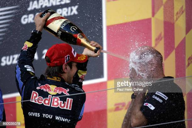 Adrian Newey Sebastian Vettel Grand Prix of Japan Suzuka Circuit 10 October 2010 Adrian Newey having a champagne shower from race winner Sebastian...