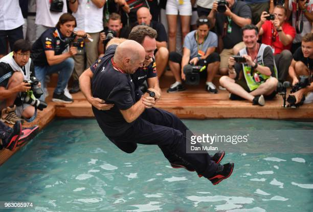 Adrian Newey the Chief Technical Officer of Red Bull Racing and Red Bull Racing Team Principal Christian Horner celebrate the race win of Daniel...