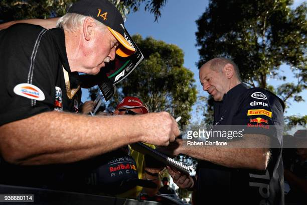 Adrian Newey the Chief Technical Officer of Red Bull Racing arrives at the circuit and signs autographs for fans before practice for the Australian...
