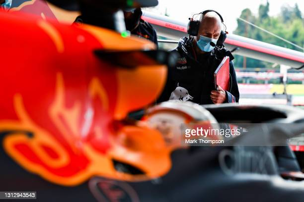 Adrian Newey, the Chief Technical Officer of Red Bull Racing looks on as Max Verstappen of Netherlands and Red Bull Racing prepares to drive during...