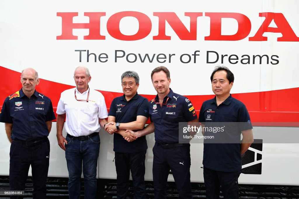 Adrian Newey, the Chief Technical Officer of Red Bull Racing, Red Bull Racing Team Consultant Dr Helmut Marko, Masashi Yamamoto of Honda, Red Bull Racing Team Principal Christian Horner and Toyohara Tanabe of Honda pose for a photo before the Formula One Grand Prix of France at Circuit Paul Ricard on June 24, 2018 in Le Castellet, France.