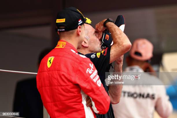 Adrian Newey the Chief Technical Officer of Red Bull Racing celebrates the win of Daniel Ricciardo of Australia and Red Bull Racing with a shoey on...