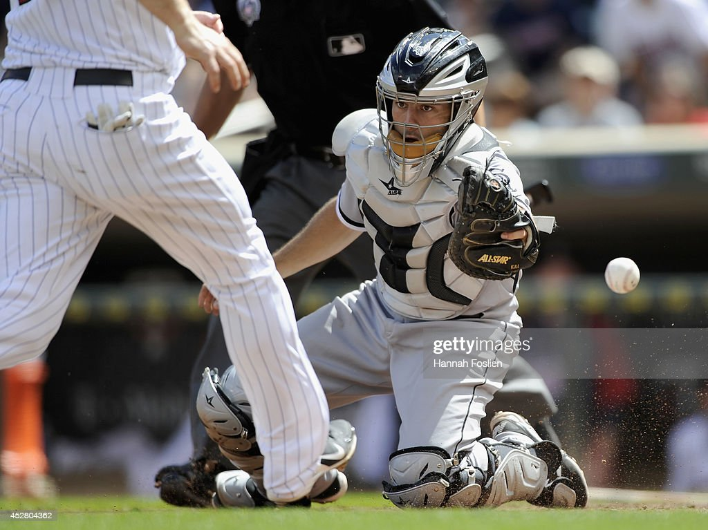 Adrian Nieto #17 of the Chicago White Sox is unable to field the ball as Josh Willingham #16 of the Minnesota Twins scores a run during the seventh inning of the game on July 27, 2014 at Target Field in Minneapolis, Minnesota. The Twins defeated the White Sox 4-3.