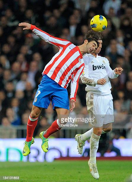 Adrian of Atletico Madrid goes for a high ball against Sergio Ramos of Real Madrid during the La Liga match between Real Madrid and Atletico Madrid...
