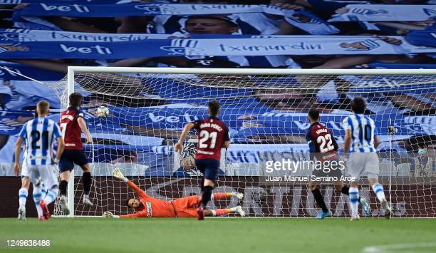 Adrian of CA Osasuna scores his teams first goal during the Liga match between Real Sociedad and CA Osasuna at Estadio Anoeta on June 14, 2020 in San...
