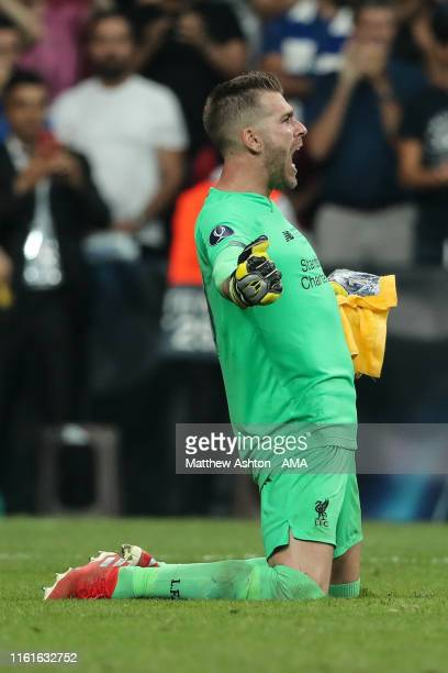 Adrian of Liverpool celebrates after saving the winning penalty from Tammy Abraham of Chelsea during the UEFA Super Cup Final fixture between...