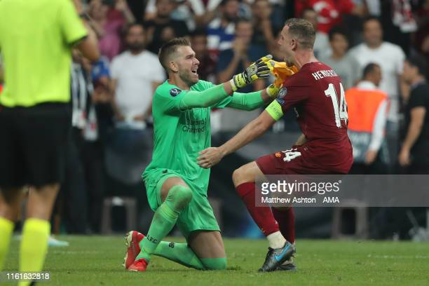 Adrian of Liverpool celebrates after saving the winning penalty from Tammy Abraham of Chelsea with Jordan Henderson of Liverpool during the UEFA...