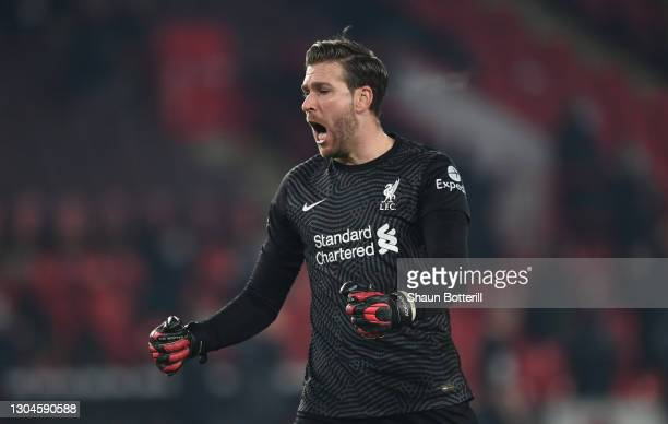 Adrian of Liverpool celebrates after their side's second goal scored by Roberto Firminho during the Premier League match between Sheffield United and...