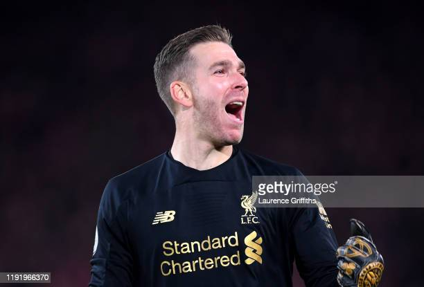 Adrian of Liverpool celebrates during the Premier League match between Liverpool FC and Everton FC at Anfield on December 04 2019 in Liverpool United...
