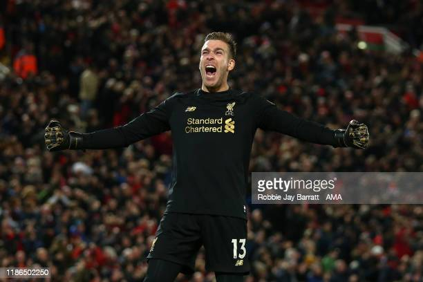 Adrian of Liverpool celebrates the goal scored by Xherdan Shaqiri of Liverpool during the Premier League match between Liverpool FC and Everton FC at...