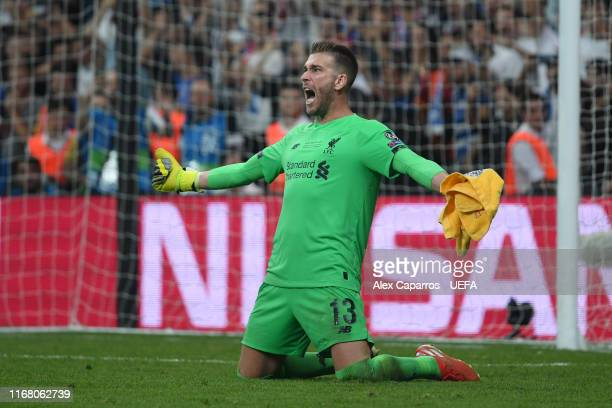 Adrian of Liverpool celebrates victory after saving the final penalty taken by Tammy Abraham of Chelsea in the penalty shoot out following the UEFA...