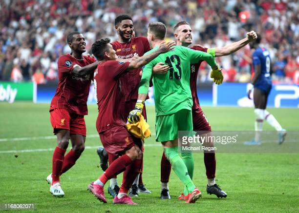 Adrian of Liverpool celebrates with team mates after making the winning penalty save taken by Tammy Abraham of Chelsea during the UEFA Super Cup...