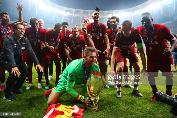 Adrian of Liverpool celebrates with the trophy and his team-mates at the end of the UEFA Super Cup match between Liverpool and Chelsea at Vodafone...