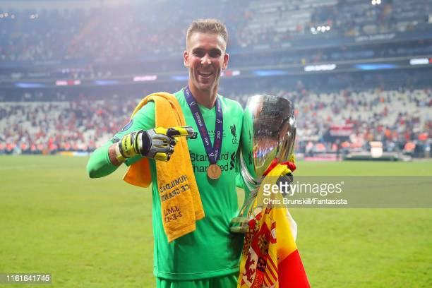 Adrian of Liverpool celebrates with the trophy at the end of the UEFA Super Cup match between Liverpool and Chelsea at Vodafone Park on August 14,...