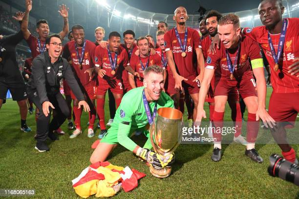 Adrian of Liverpool celebrates with the UEFA Super Cup trophy as Liverpool celebrates victory following the UEFA Super Cup match between Liverpool...