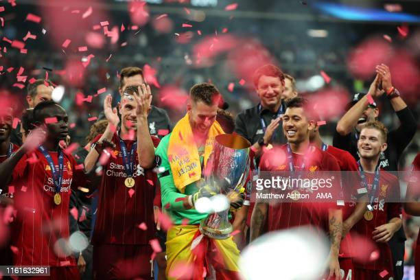 Adrian of Liverpool celebrates with the UEFA Super Cup trophy during the UEFA Super Cup Final fixture between Liverpool and Chelsea at Vodafone Park...