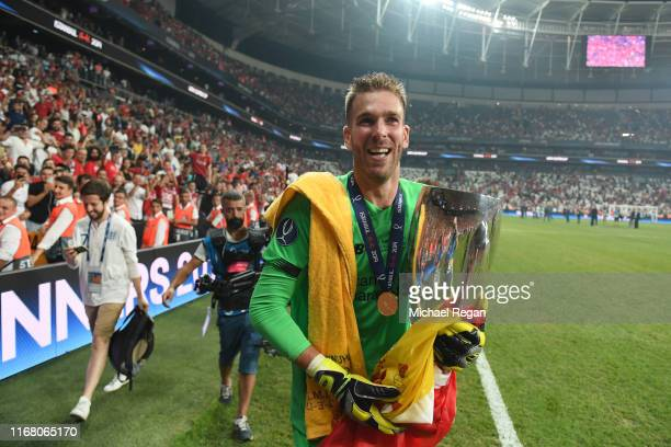 Adrian of Liverpool celebrates with the UEFA Super Cup trophy following victory in the UEFA Super Cup match between Liverpool and Chelsea at Vodafone...