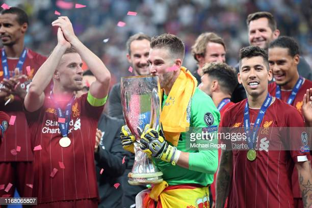 Adrian of Liverpool kisses the UEFA Super Cup trophy following victory in the UEFA Super Cup match between Liverpool and Chelsea at Vodafone Park on...