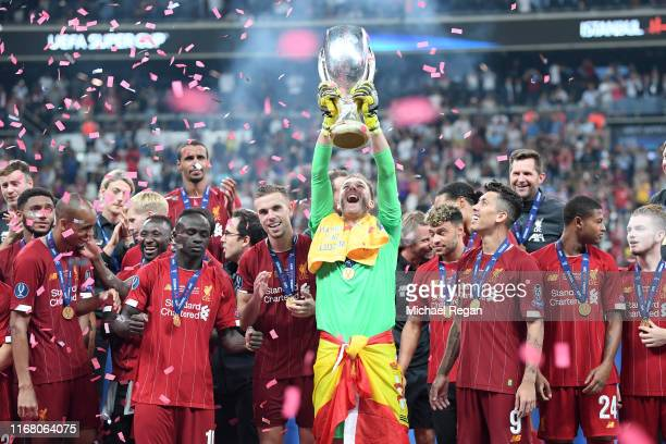 Adrian of Liverpool lifts the UEFA Super Cup trophy as Liverpool celebrate victory following the UEFA Super Cup match between Liverpool and Chelsea...